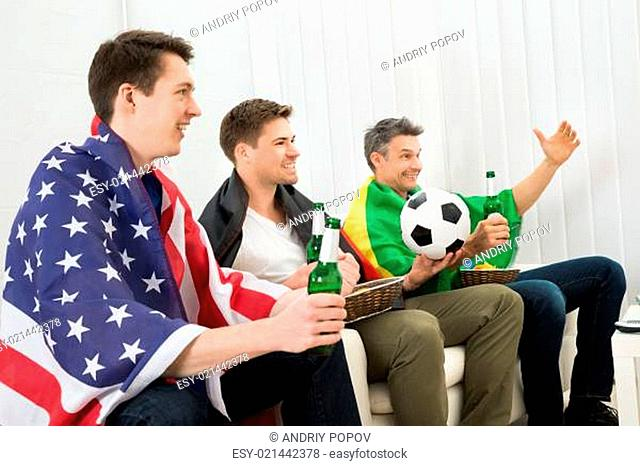 Friends Of Different Nation Supporting Football Team