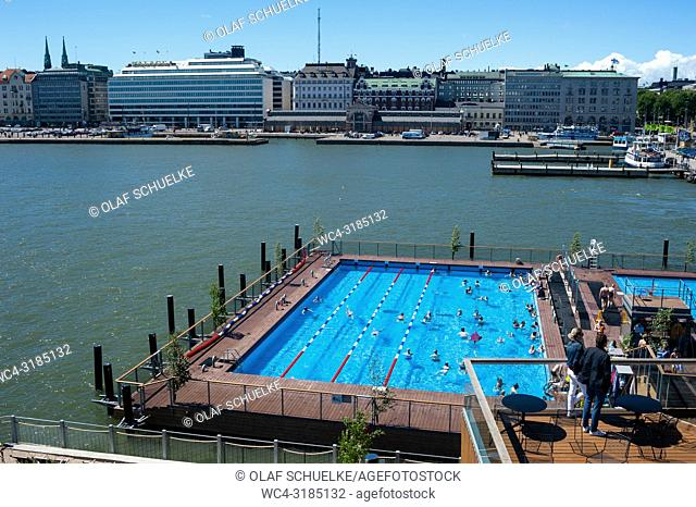 Helsinki, Finland, Europe - An elevated view of one of the swimming pools of the Allas Sea Pool with the harbour and adjacent buildings along the waterside in...