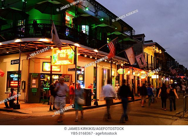 The nightlife on Bourbon Street in the New Orleans French Quarter heats up as the sun goes down