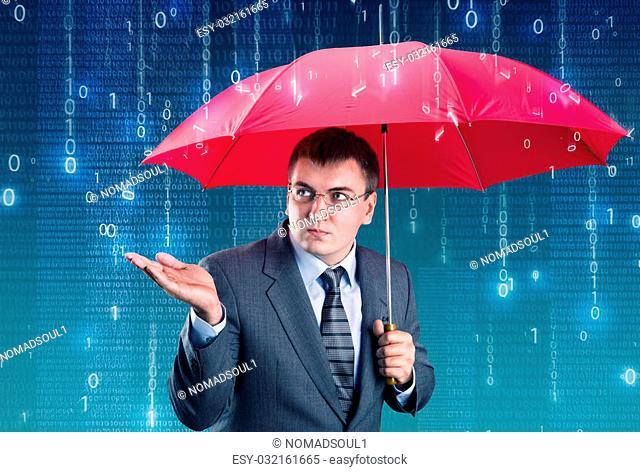 Office worker hiding under an umbrella from digital rain