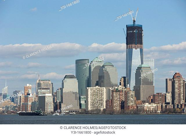 The rising One World Trade Center Freedom Tower and Manhattan skyline in New York City as viewed from New York Harbor