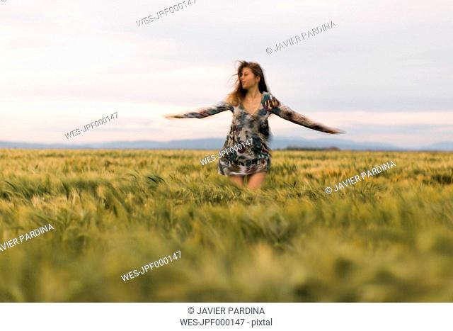 Woman dancing on a field