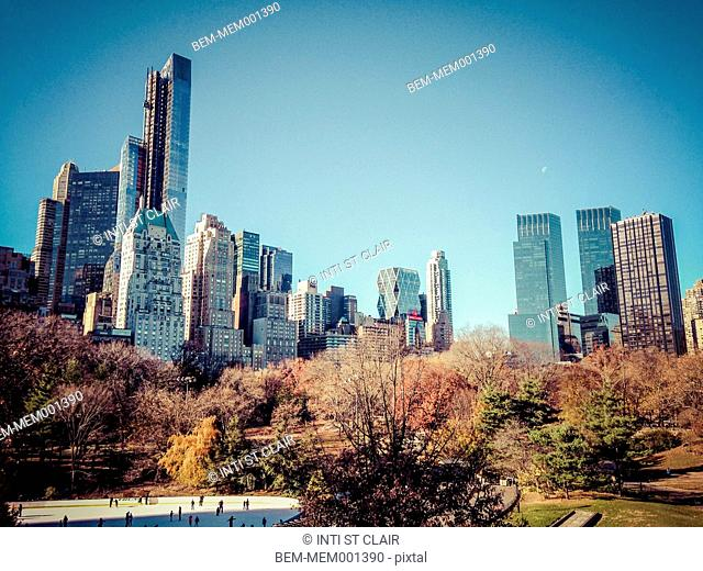 Skyscrapers overlooking urban park, New York, New York, United States