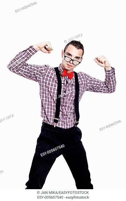 Self-confident nerd man showing his power, isolated on white background