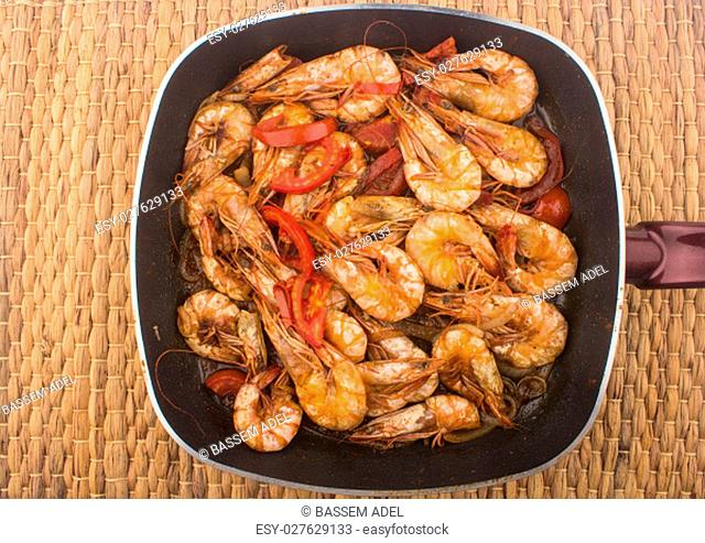 Cooked Fresh Shrimp with Tomato and Onions / Cooked Fresh Shrimp with Tomato and Onions Served in a plate on a Wooden ( Black Ceramic) background