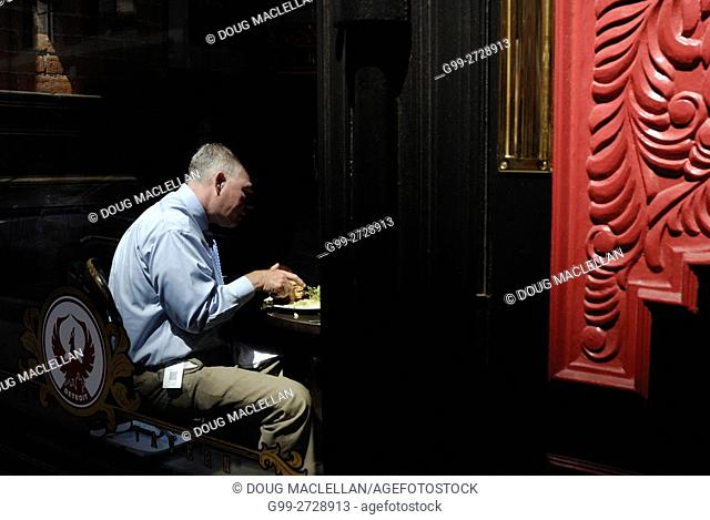 Man eats his lunch at a classy restaurant in Detroit, Michigan's Greektown neighbourhood, a well known tourist, gaming and sports area