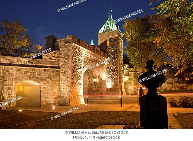 """Canada, Quebec City, Old Quebec, tower and gate in city wall, """"""""Porte St. Louis"""""""" over Rue Saint-Louis, with bust of Mahatma Ghandi"""