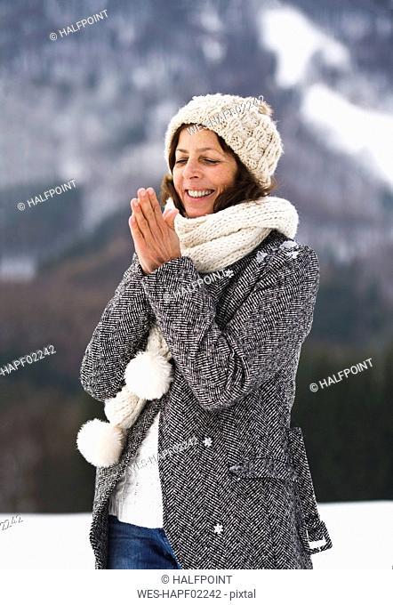 Portrait of happy senior woman in winter