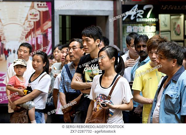 People seeing Shanghai Puppet Show in the ancient town, Shanhai. The Chinese love their children, and are restricted, if city dwellers, to but one