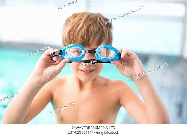 Cute little boy standing poolside