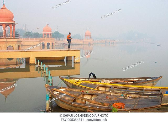 Small boats at Kudia Ghat of Gomati river ; Lucknow ; Uttar Pradesh ; India