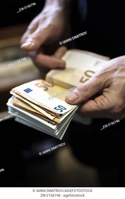Counting cash-euro banknotes-selective focus