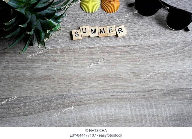 044c8edc4cb0 flat lay top view summer word written on wooden block with sunglasses,  seashell and head