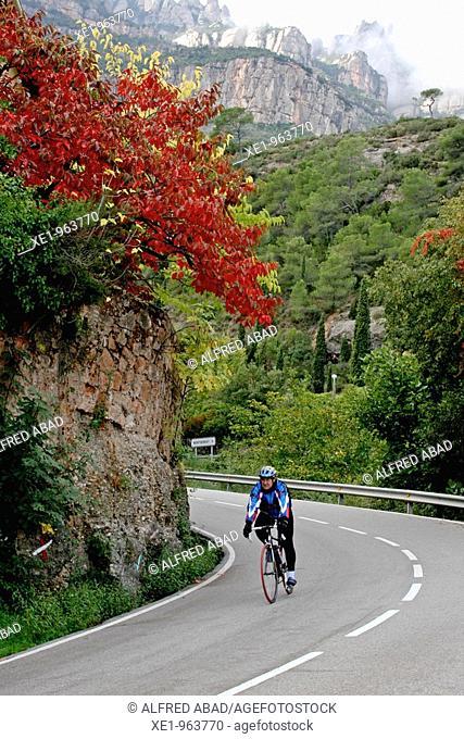 Cyclist, road acces to Montserrat mountain, Monistrol de Montserrat, Catalonia, Spain