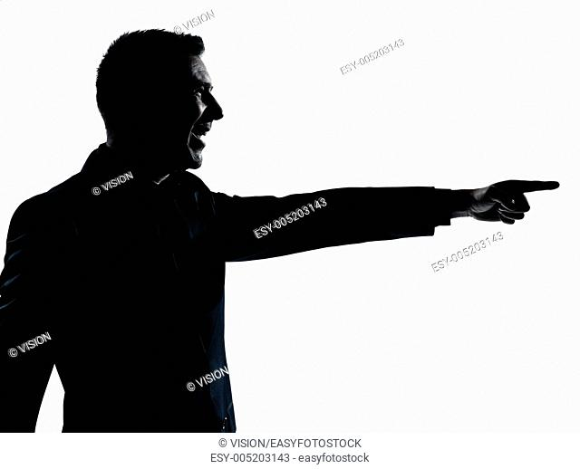 one caucasian business man poiting portrait silhouette in studio isolated on white background