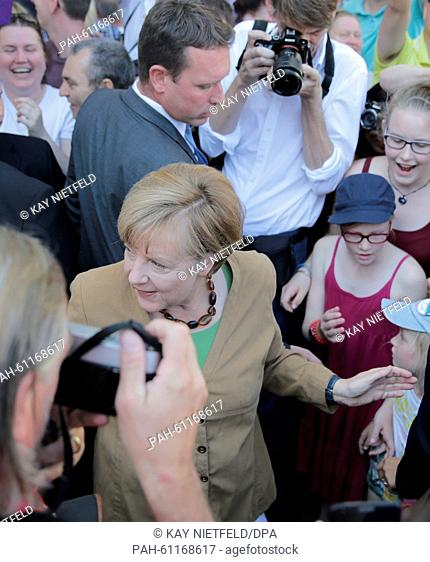 German Chancellor Angela Merkel (CDU) greets visiting citizens at the Bundeskanzleramt, during a German government open day in Berlin, Germany, 30 August 2015