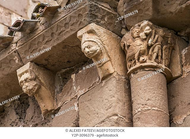Corbels in the apse of Romanesque church San Andrés of 12th century in Soto de Bureba, province Burgos, Castile and Leon, Spain