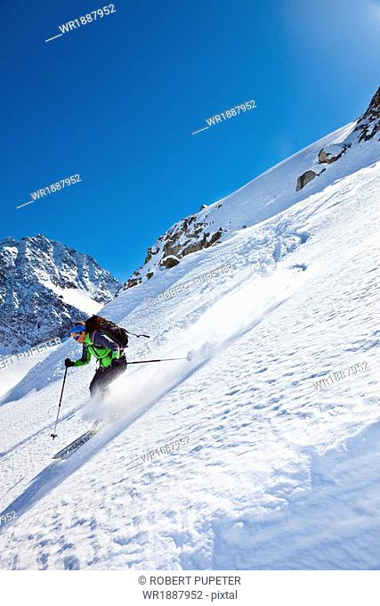 Female skier skiing downhill, Stubai, Tyrol, Austria