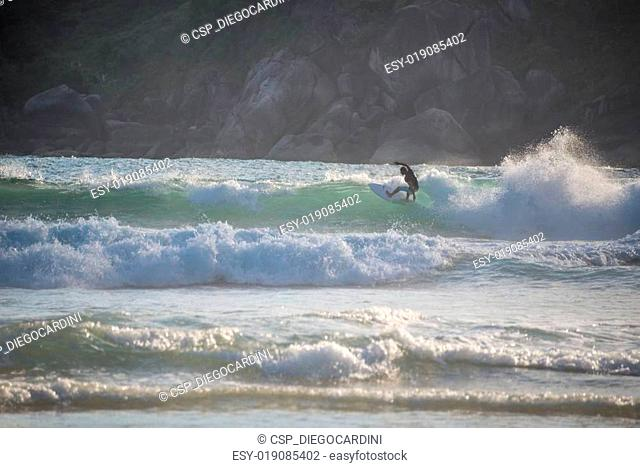 Surfer Enjoying the Waves at Bonete beach.Ilhabela, Sao Paulo. B