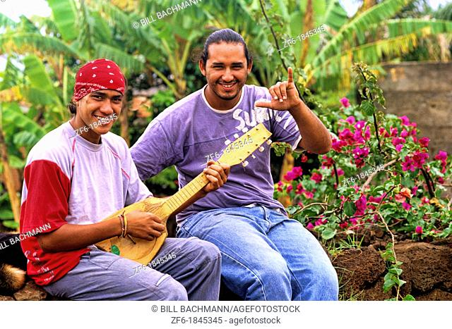Local native men playing music Easter Island during Tapati Festival Rapa Nui