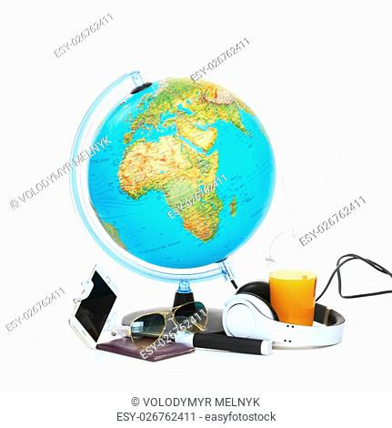The blue globe, phone, sunglasses and headphones on white background. The travel, tourism and holidays concept