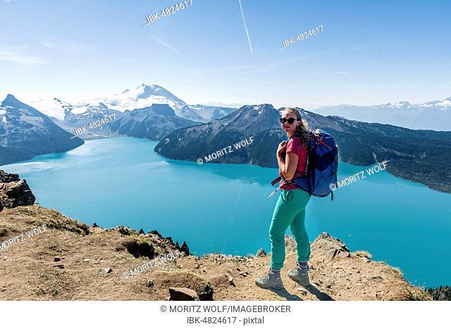 View from Panorama Ridge Hiking Trail, Hiker, Garibaldi Lake, Guard Mountain and Deception Peak, Glacier, Garibaldi Provincial Park, British Columbia, Canada