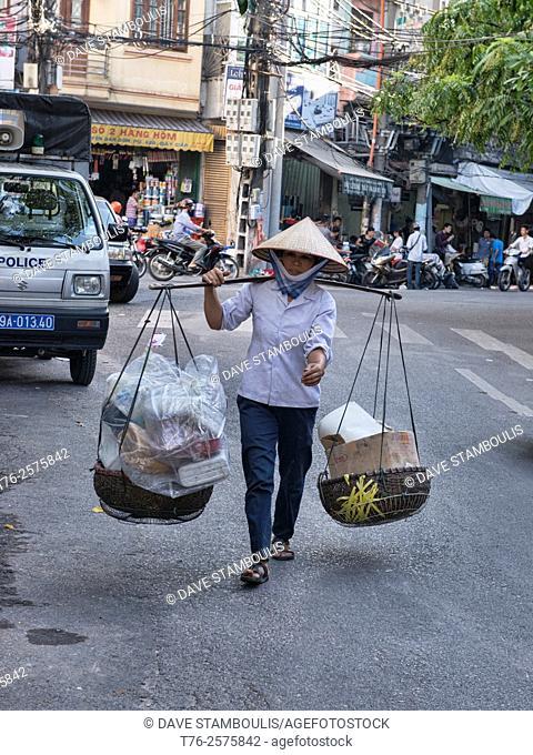 Street vendor and her wares, Hanoi, Vietnam