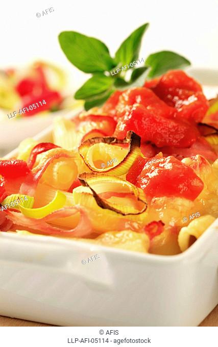 Pasta with ham and cheese in a casserole dish