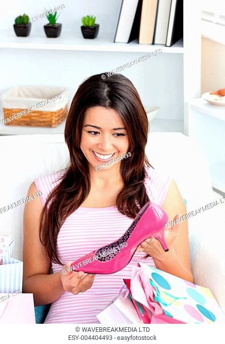 Beautiful woman holding shoe in her hand