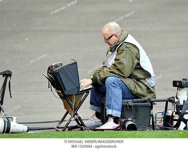 Press photographer at work