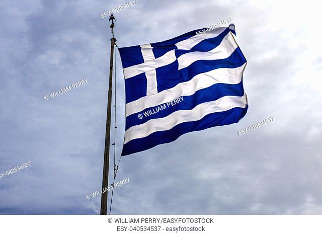 Blue White Greek Flag Summit Acropolis Athens Greece. Cross symbolizes Greek Orthordox Chritiianity, the religion of Greece, Acropolis is symbol of Athens