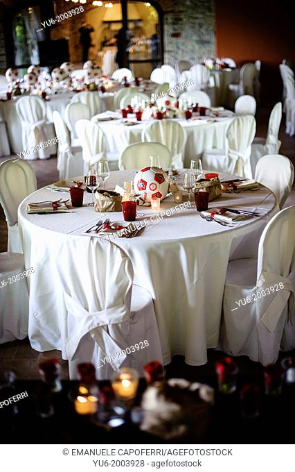 Room of restaurant prepared for wedding