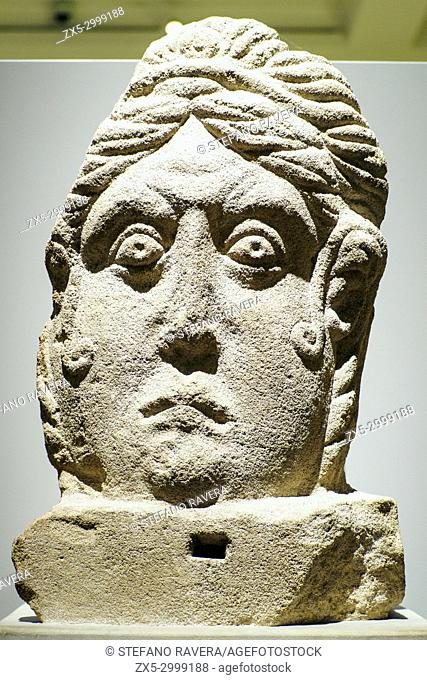 Limestone head. Towcester, Northamptonshire. The head is a fusion of native British and Roman styles. . It was probably a finial from a funerary monument or...