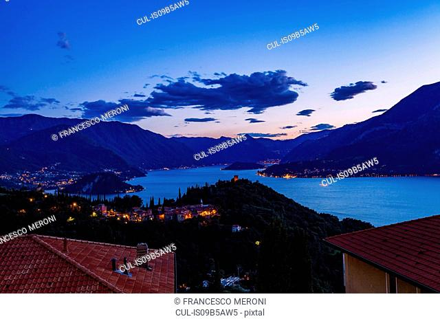 Buildings illuminated in the evening by Lake Como, Varenna, Italy