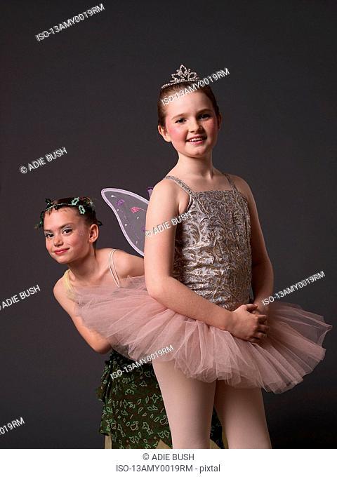 Girl in pink tutu & girl in green dress