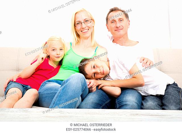 A happy Family at home on the sofa
