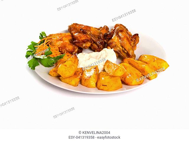 Fried chicken wings with baked potatoes and garlic mayo