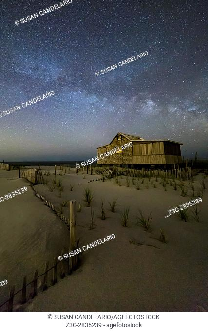 Starry Skies and Milky Way At NJ Shore - Island Beach State Park at the NJ Shore with beach fences leading to the Judge's Shack underneath a starry sky with the...