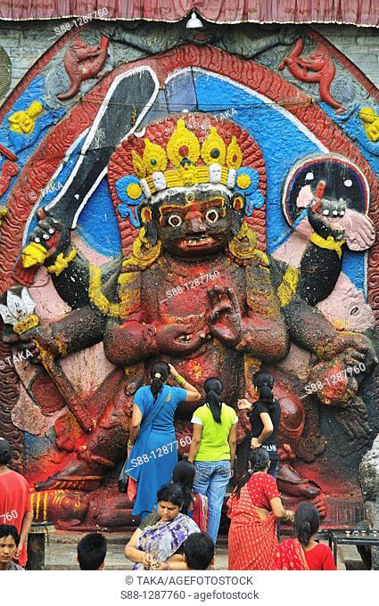 Women pray for Kar Bhairav at Hanuman-dhoka Durbar, the heart of Kathmandu