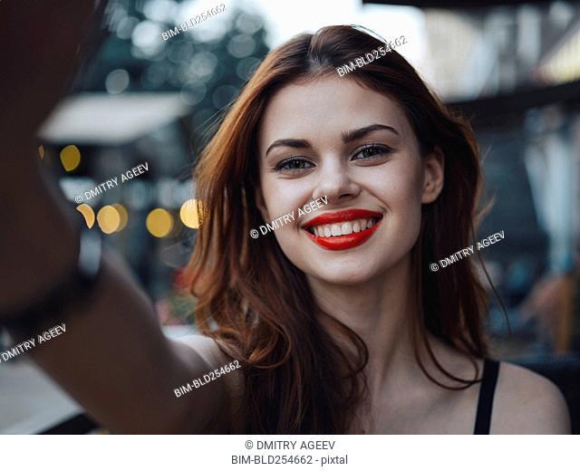 Smiling Caucasian woman posing for selfie