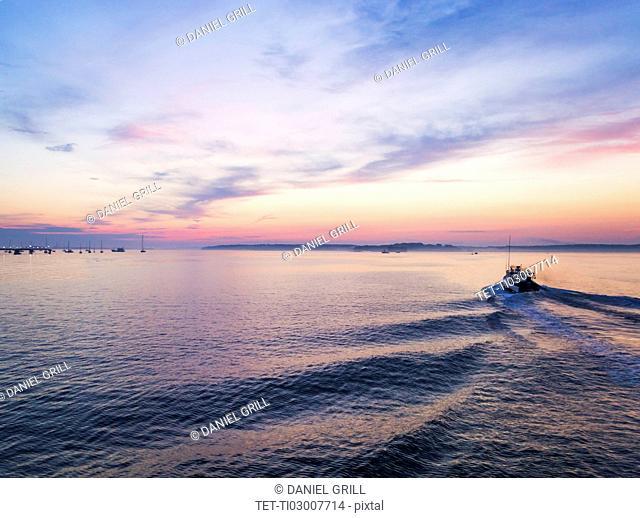 Fishing boat heading towards harbor