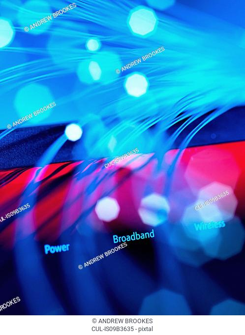 Fibre optics shooting past a broadband hub illustrating digital communications