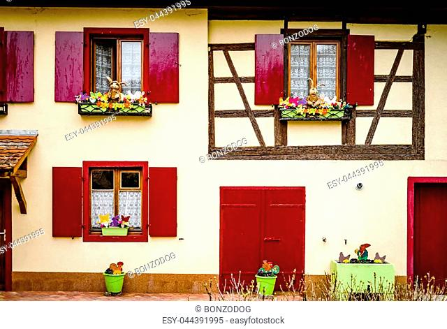 Old classic windows in historical village in Alsace, France