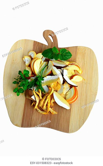 Mushroom soup ingredients, delicious forest mushrooms - Caesar's Mushroom, Chanterelle and Porcini, sliced on the wooden chopping board together with fresh