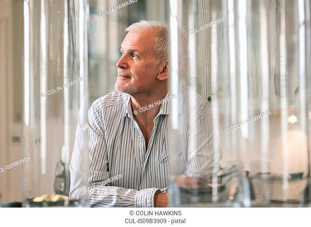 Man daydreaming at home