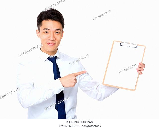 Businessman finger point to clipboard