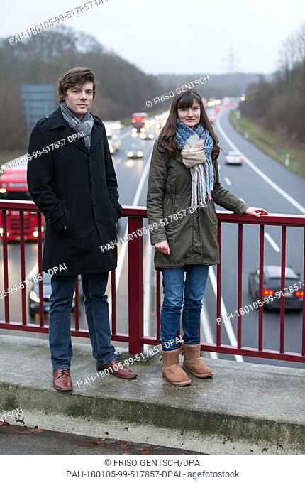 The filmmakers Emanuel Zander-Fusillo (L) and Elena Walter stand on a freeway bridge in Osnabrueck, Germany, 04 January 2018