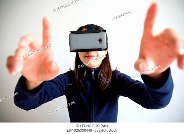 Young woman touch panel with vr device