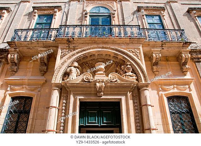 Doorway and balcony of the Banca Guiratale Town Hall of Mdina, Malta  Built in 1730 it now houses the National Archives