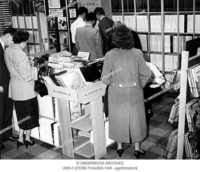 New York, New York: October, 1955 Customers perusing the wide assortment of RCA Victor and other brands of 78 and 45rpm and LP records in the Hudson Radio Shop
